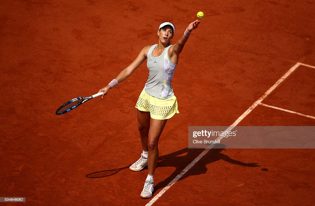 Garbine Muguruza of Spain serves during the Ladies Singles third round match against Yanina Wickmayer of Germany on day six of the 2016 French Open at Roland Garros on May 27, 2016 in Paris, France.