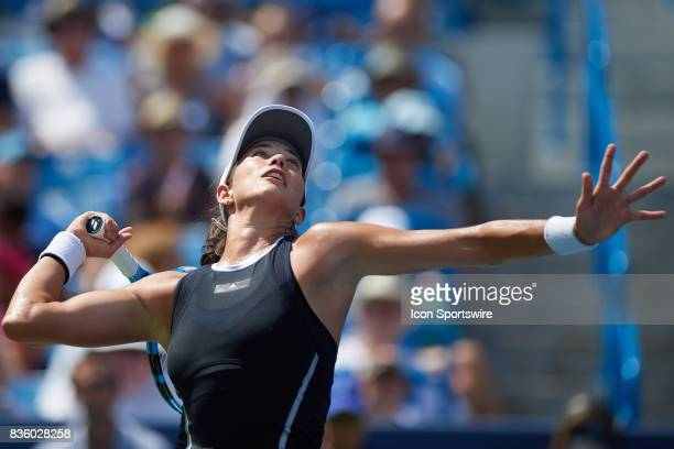 Garbine Muguruza of Spain serves the ball to Simona Halep of Romania during the ladies finals in the Western Southern Open at the Lindner Family...