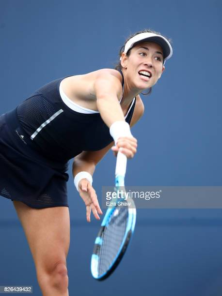 Garbine Muguruza of Spain serves to Ana Konjuh of Croatia during their quarterfinal match on Day 5 of the Bank of the West Classic at Stanford...