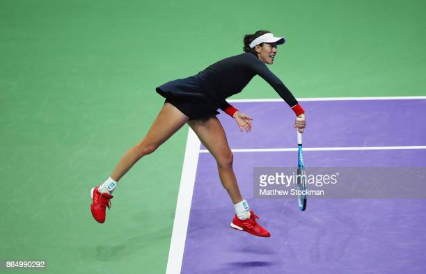 Garbine Muguruza of Spain serves to Jelena Ostapenko of Latvia during day 1 of the BNP Paribas WTA Finals Singapore presented by SC Global at...