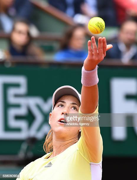 Garbine Muguruza of Spain serves to Serena Williams of the USA during women's single final match at the French Open tennis tournament at Roland...