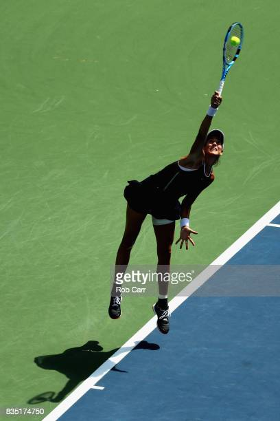 Garbine Muguruza of Spain serves to Svetlana Kuznetsova of Russia during Day 7 of the Western and Southern Open at the Linder Family Tennis Center on...