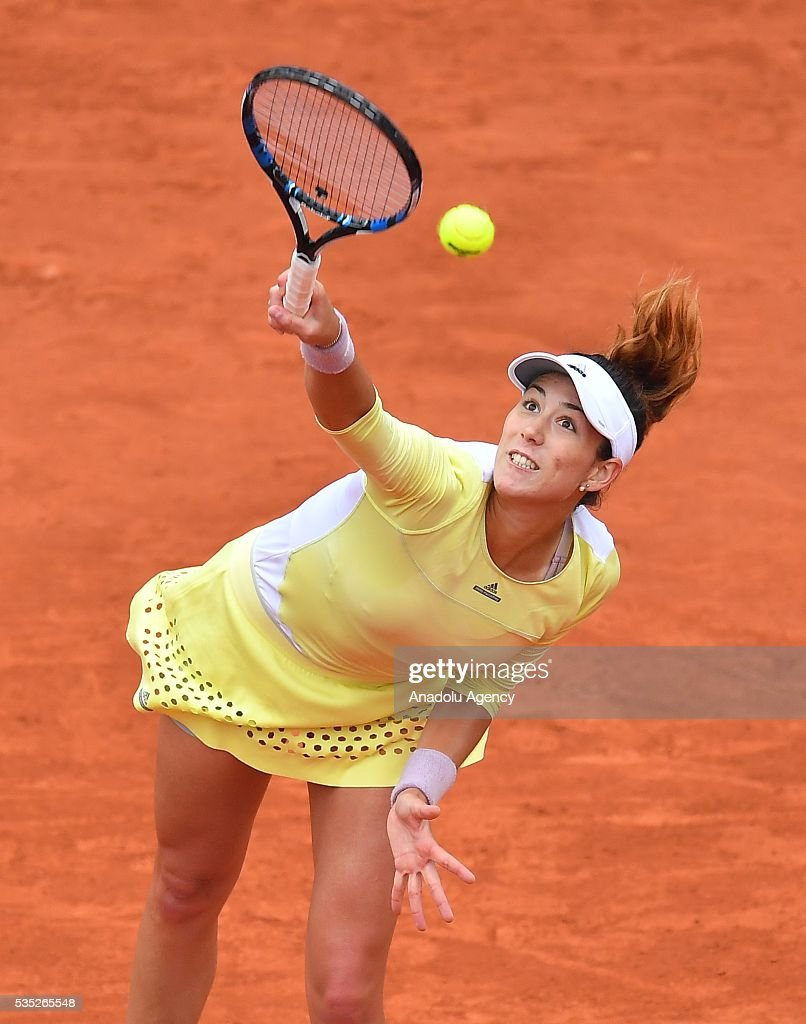 Garbine Muguruza of Spain serves to Svetlana Kuznetsova (not seen) of Russia during the women's single fourth round match at the French Open tennis tournament at Roland Garros Stadium in Paris, France on May 29, 2016.