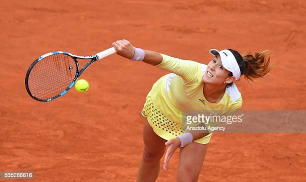 Garbine Muguruza of Spain serves to Svetlana Kuznetsova of Russia during the women's single fourth round match at the French Open tennis tournament...