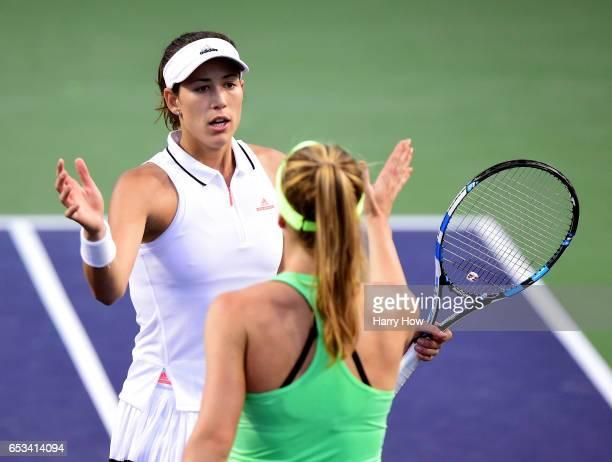 Garbine Muguruza of Spain shakes hands with Elina Svitolina of Ukraine after her win during the BNP Paribas Open at Indian Wells Tennis Garden on...