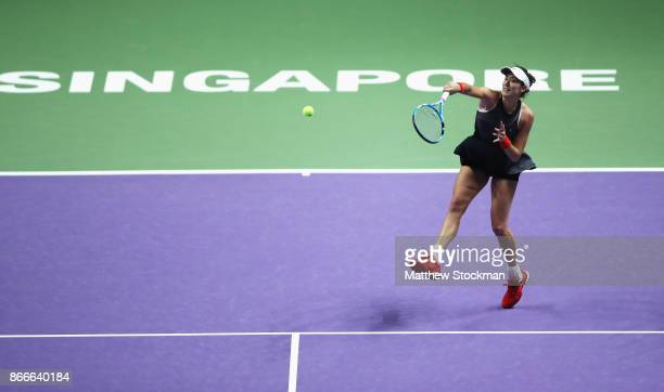 Garbine Muguruza of Spain smashes in her singles match against Venus Williams of the United States during day 5 of the BNP Paribas WTA Finals...