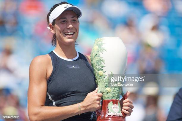 Garbine Muguruza of Spain smiles with the Rookwood Cup after winning the ladies finals match against Simona Halep of Romania in the Western Southern...
