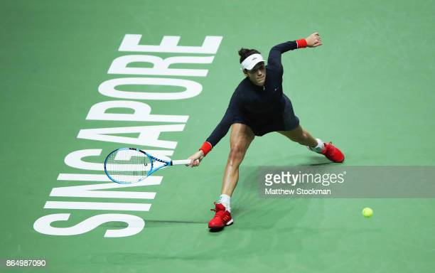 Garbine Muguruza of Spain stretches for a forehand in her singles match against Jelena Ostapenko of Latvia during day 1 of the BNP Paribas WTA Finals...
