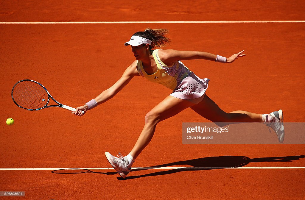 Garbine Muguruza of Spain stretches to play a forehand volley against Anna Karolina Schmiedlova of Slovakia in their first round match during day two of the Mutua Madrid Open tennis tournament at the Caja Magica on May 01, 2016 in Madrid,Spain