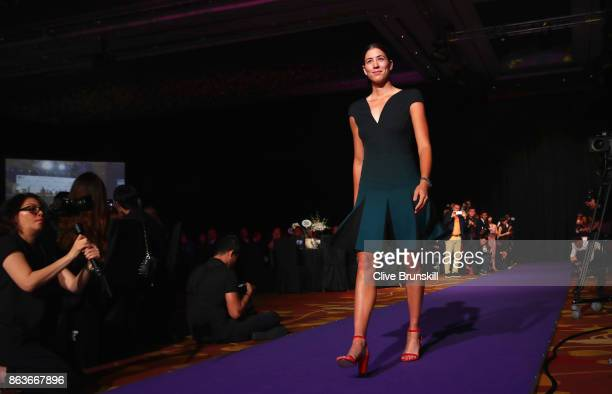 Garbine Muguruza of Spain walks in to the Official Draw Ceremony and Gala of the BNP Paribas WTA Finals Singapore presented by SC Global at Marina...