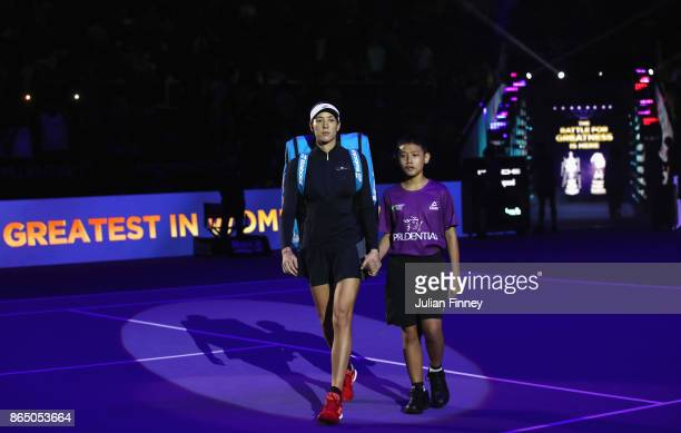 Garbine Muguruza of Spain walks out for her singles match against Jelena Ostapenko of Latvia during day 1 of the BNP Paribas WTA Finals Singapore...