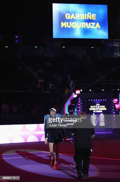 Garbine Muguruza of Spain walks out for her singles match against Venus Williams of the United States during day 5 of the BNP Paribas WTA Finals...