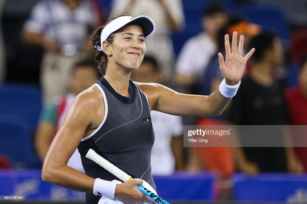 Garbine Muguruza of Spain waves to the camera after winning the second round Ladies Singles match against Lesia Tsurenko of Ukraine on Day 3 of 2017 Dongfeng Motor Wuhan Open at Optics Valley International Tennis Center on September 26, 2017 in Wuhan, China.