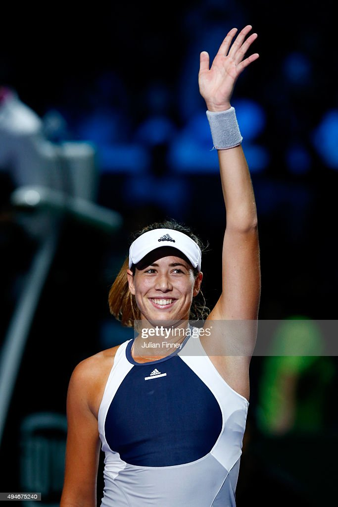 Garbine Muguruza of Spain waves to the crowd after defeating Angelique Kerber of Germany during the BNP Paribas WTA Finals at Singapore Sports Hub on October 28, 2015 in Singapore.