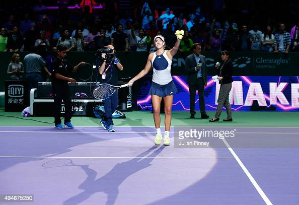 Garbine Muguruza of Spain waves to the crowd after defeating Angelique Kerber of Germany during the BNP Paribas WTA Finals at Singapore Sports Hub on...
