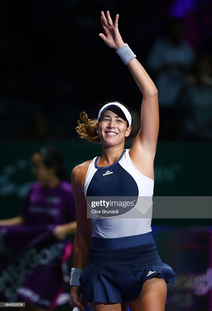 Garbine Muguruza of Spain waves to the crowd after defeating Lucie Safarova of Czech Republic in a round robin match during the BNP Paribas WTA Finals at Singapore Sports Hub on October 26, 2015 in Singapore.