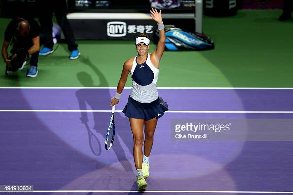 Garbine Muguruza of Spain waves to the crowd after defeating Petra Kvitova of Czech Republic in a round robin match during the BNP Paribas WTA Finals...