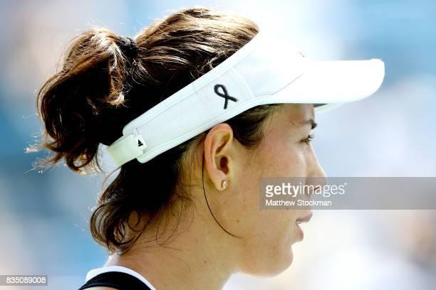Garbine Muguruza of Spain wears a black ribbon on her visor in her match against Svetlana Kuznetsova to honor the victims of the terrorist attack in...