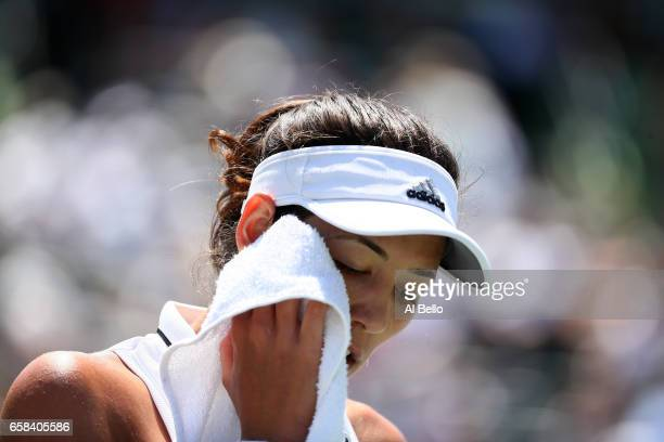 Garbine Muguruza of Spain wipes her face with a towel during her game against Caroline Wosniacki of Denmark during Day 8 of the Miami Open at Crandon...