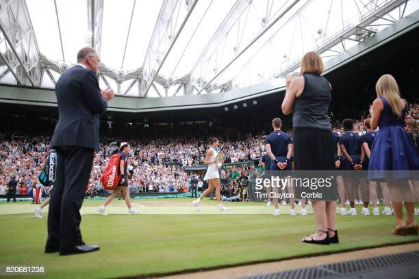 Garbine Muguruza of Spain with the winners trophy after the Ladies Singles Final during the Wimbledon Lawn Tennis Championships at the All England...