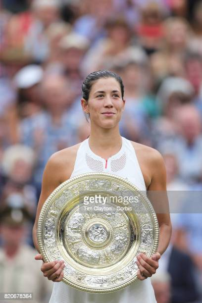 Garbine Muguruza of Spain with the winners trophy after victory in the Ladies Singles final defeating Venus Williams of The United States during the...