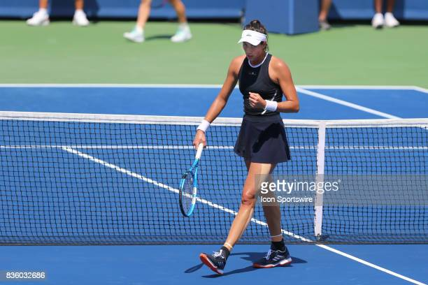 Garbine Muguruza reacts during the championship match against Simona Halep During the Western Southern Open at the Lindner Family Tennis Center in...