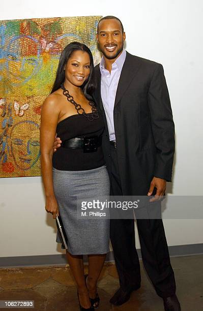 Garcelle Beauvais and Henry Simmons during Hunt Slonem Art Exhibit Celebrity Dinner at Don O'Melveny Gallery in Los Angeles California United States
