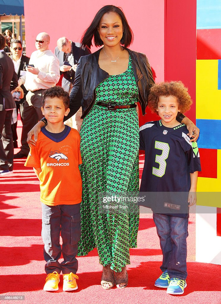 <a gi-track='captionPersonalityLinkClicked' href=/galleries/search?phrase=Garcelle+Beauvais&family=editorial&specificpeople=203112 ng-click='$event.stopPropagation()'>Garcelle Beauvais</a> (C) and her children arrive at the Los Angeles premiere of 'The Lego Movie' held at Regency Village Theatre on February 1, 2014 in Westwood, California.