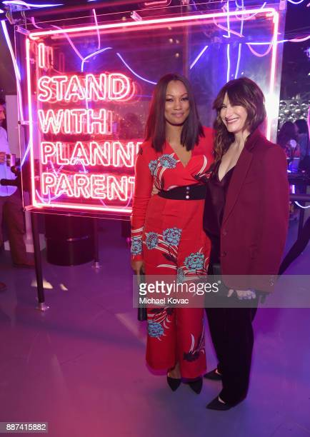 Garcelle Beauvais and Kathryn Hahn attend Refinery29 29Rooms Los Angeles Turn It Into Art Opening Night Party at ROW DTLA on December 6 2017 in Los...