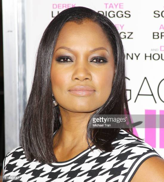 Garcelle Beauvais arrives at the Los Angeles premiere of 'Baggage Claim' held at Regal Cinemas LA Live on September 25 2013 in Los Angeles California