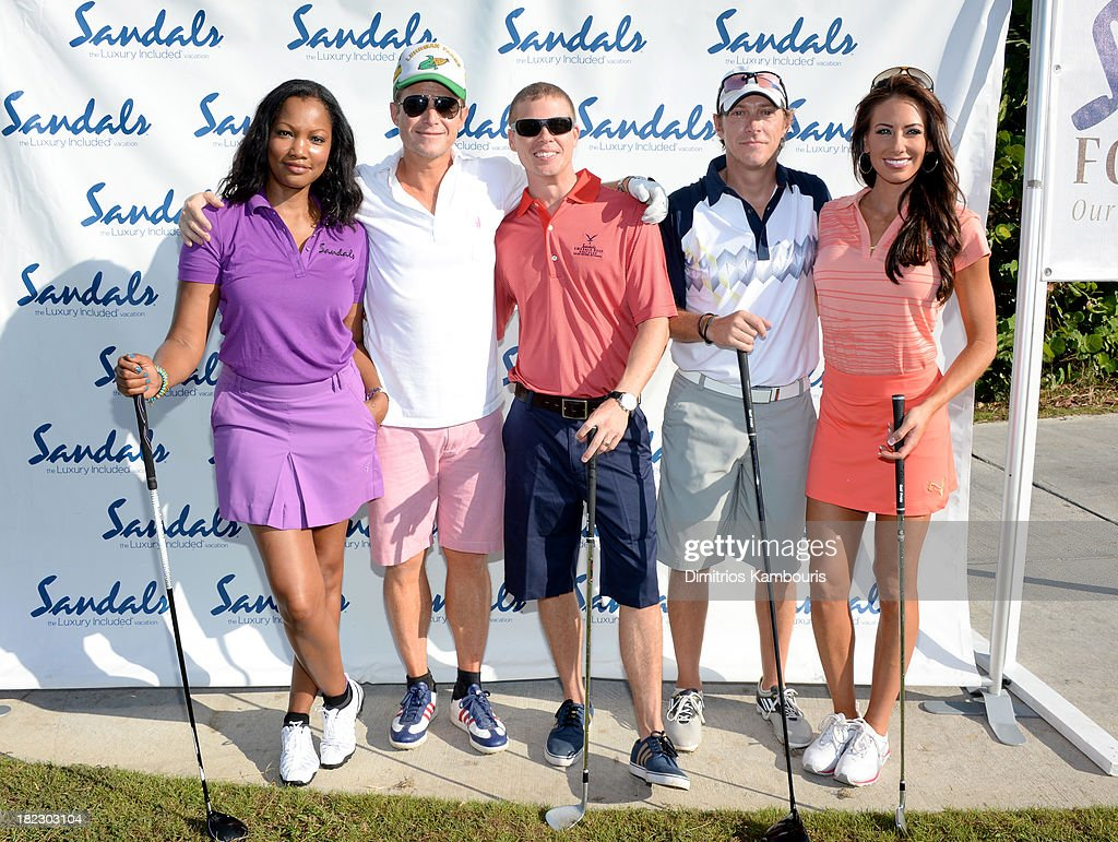 Garcelle Beauvais, Billy Bush, Sandals Resorts International CEO Adam Stewart, Kevin Rahm, and Holly Sonders attend the Golf Clinic with Greg Norman and Golf Tournament during Day Three of the Sandals Emerald Bay Celebrity Getaway And Golf Weekend on September 29, 2013 at Sandals Emerald Bay in Great Exuma, Bahamas.