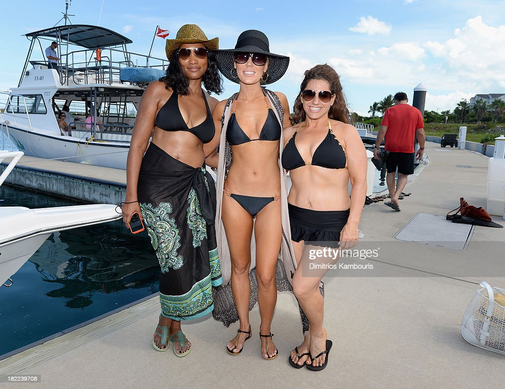 <a gi-track='captionPersonalityLinkClicked' href=/galleries/search?phrase=Garcelle+Beauvais&family=editorial&specificpeople=203112 ng-click='$event.stopPropagation()'>Garcelle Beauvais</a>, <a gi-track='captionPersonalityLinkClicked' href=/galleries/search?phrase=Gretchen+Rossi&family=editorial&specificpeople=5637804 ng-click='$event.stopPropagation()'>Gretchen Rossi</a>, and <a gi-track='captionPersonalityLinkClicked' href=/galleries/search?phrase=Marissa+Jaret+Winokur&family=editorial&specificpeople=206425 ng-click='$event.stopPropagation()'>Marissa Jaret Winokur</a> attend the Island Routes Caribbean Adventures during Day Two of the Sandals Emerald Bay Celebrity Getaway And Golf Weekend on September 28, 2013 at Sandals Emerald Bay in Great Exuma, Bahamas.