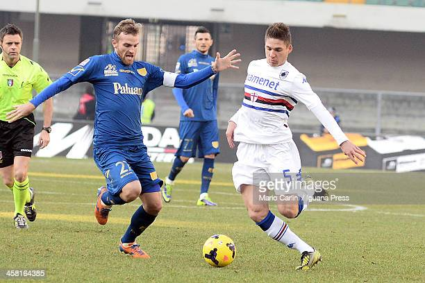 Garcia Renan of UC Sampdoria competes the ball with Luca Rigoni of AC Chievo Verona during the Seria A match between AC Chievo Verona and UC...