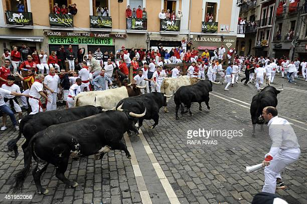 Garcigrande's bulls arrive at the City Hall square during the fourth bullrun of the San Fermin Festival in Pamplona northern Spain on July 10 2014...