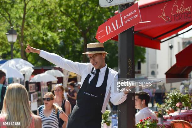 A 'Garcon du Cafe' from 'La Boheme Du Tertre' trying to invite passersby at The Place du Tertre square in Montmartre quarter On Friday June 14 in...