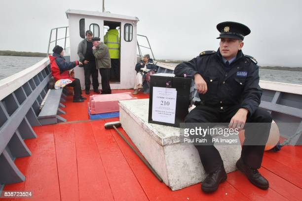 Garda Brendan McCann takes the ballot box for the Lisbon Treaty voting across to Inishfree Island off the coast of Co Donegal where just seven people...