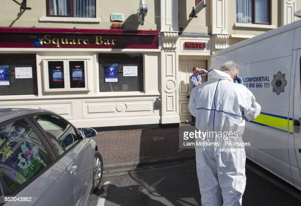 Garda forensic officers search the Square Bar in Market Street Bailieborough in County Cavan where a man barricaded himself in the pub armed with a...