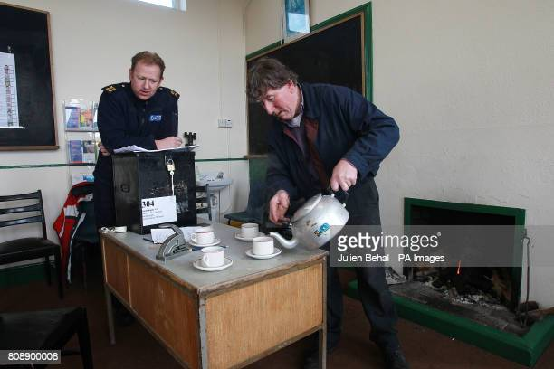 Garda Martin Reilly from Achill chats with Presiding Officer Micheal Leneghan over tea and sandwiches in the polling station in Scoil Mhuire on...