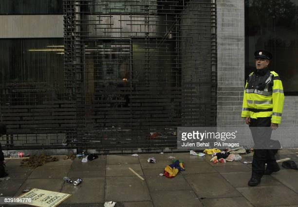 A Garda officer stands outside the Department of Finance buildings off StStephens Green Dublin following a students protest against an increase in...