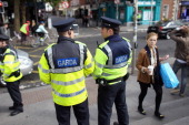 Garda police officers patrol the streets of Dublin ahead of the arrival of the Queen on May 17 2011 in Dublin Ireland The visit by Queen Elizabeth II...