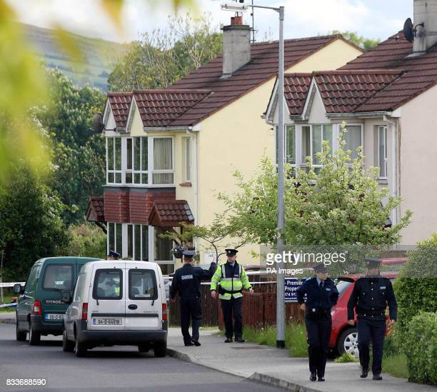 Gardai at the house at Whitethorn Close Letterkenny Co Donegal where a young mother and her sevenyearold daughter were found dead