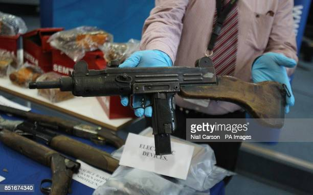 Gardai display arms and explosives including an Uzi Submachine gun recently recovered from dissident republicans in the Dublin area in recent days at...