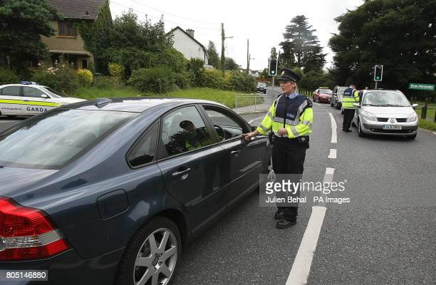 Gardai stop and question motorists on Watery Lane in Clondalkin Dublin during a search for the parents of a twoyearold boy found wandering alone...