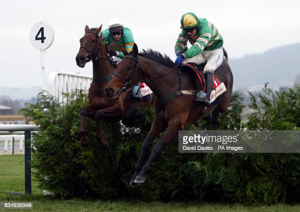 Garde Champetre ridden by Miss Nina Carberry jumps the last ahead of L'Ami ridden by John McNamara to win the Glenfarclas Cross Country Handicap...