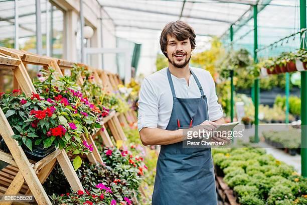 Garden center owner with digital tablet