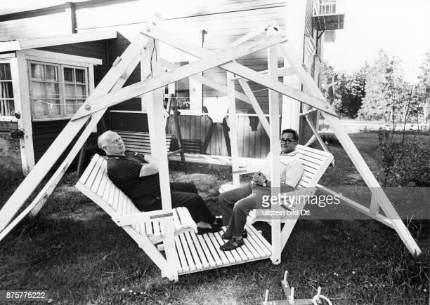 Garden furniture two elderly men sitting in a selfmade wooden construction in Haparanda