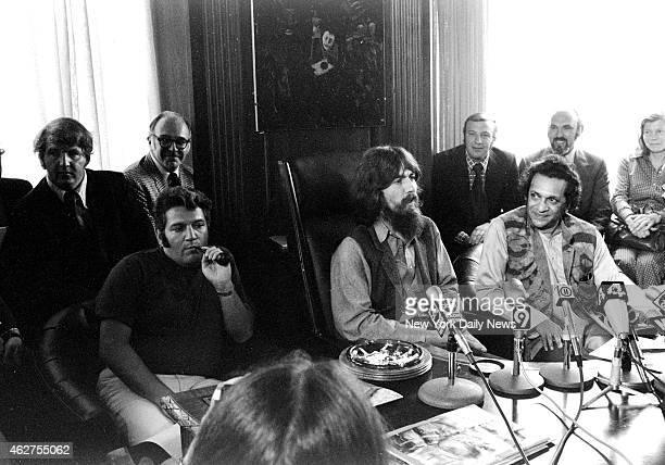 Garden George Harrison flanked by pipe smoking Allen Klein and Ravi Shankar speaks to reporters about benefit show for East Pakistan refugee children