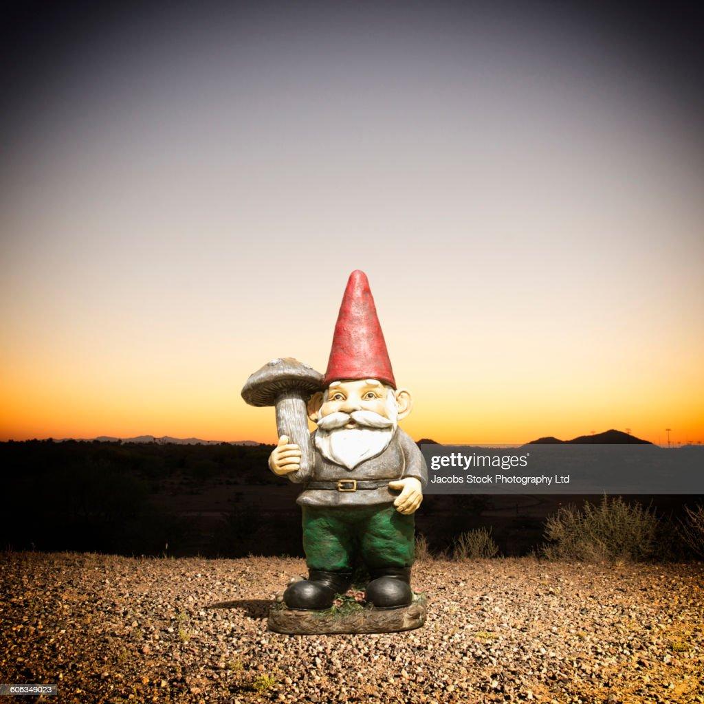 Garden gnome in remote desert