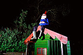 Garden gnome on garden shed roof