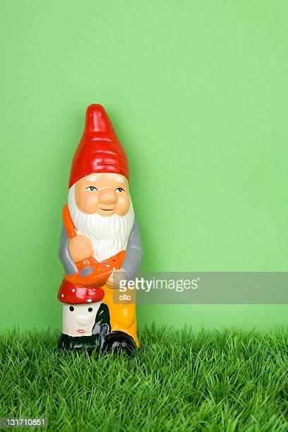 Garden gnome on green grass